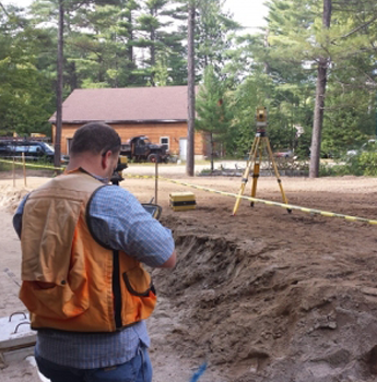 Man Surveying a Residential Land
